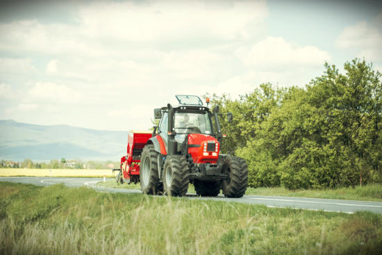 tractor driving on the road